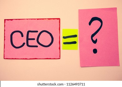 Handwriting text Ceo. Concept meaning Chief Executive Officer Head Boss Chairperson Chairman Controller Ideas messages pink papers communicate intention equal sign question mark.