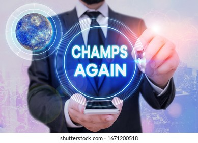 Handwriting text Champs Again. Concept meaning refers to winner or someone who excels and enjoys victories Elements of this image furnished by NASA.