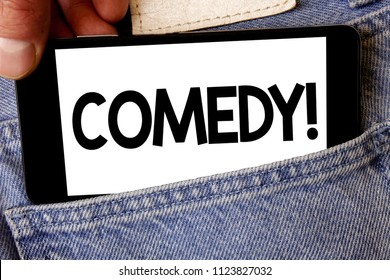 Handwriting text Comedy Call. Concept meaning Fun Humor Satire Sitcom Hilarity Joking Entertainment Laughing Man hold holding cell phone white screen message application technology.