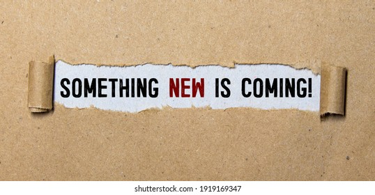 Handwriting text Coming Soon. Concept meaning something is going to happen in really short time of period Colored clipboard blank paper sheet marker old wooden vintage background.