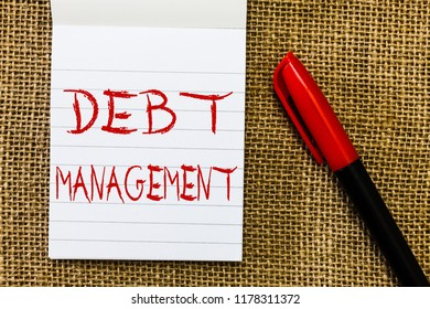 Handwriting text Debt Management. Concept meaning The formal agreement between a debtor and a creditor