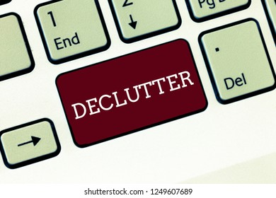 Handwriting text Declutter. Concept meaning remove unnecessary items from untidy or overcrowded place Keyboard key Intention to create computer message, pressing keypad idea.