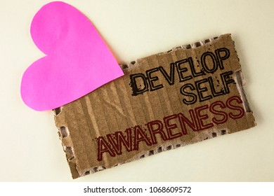 Handwriting text Develop Self Awareness. Concept meaning What you think you become motivate and grow written Tear Cardboard Piece on the plain background Heart next to it.