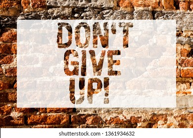 Handwriting text Don T Give Up. Concept meaning you should continue doing what you are good at Resist Brick Wall art like Graffiti motivational call written on the wall.