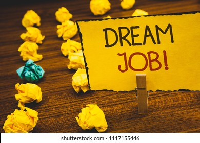 Handwriting text Dream Job Motivational Call. Concept meaning To work in what you like Fulfilling activitiesClothespin holding Yellow paper ideas crumpled papers wooden background.