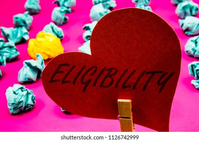 Handwriting text Eligibility. Concept meaning State of having the right for doing or obtain something Proper Clothespin holding red heart paper crumpled papers ideas mistakes trials.