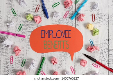 Handwriting text Employee Benefits. Concept meaning Indirect and noncash compensation paid to an employee Blank speech bubble pens clips crushed paper balls vintage retro table.