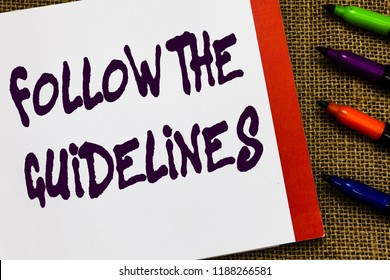 Handwriting text Follow The Guidelines. Concept meaning Manual of Style Follow a Specified Rule Accordingly Open notebook page jute background colorful markers Expressing ideas.