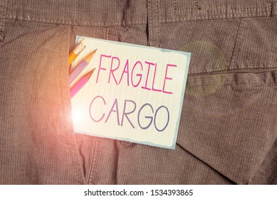 Handwriting text Fragile Cargo. Concept meaning Breakable Handle with Care Bubble Wrap Glass Hazardous Goods Writing equipment and white note paper inside pocket of man work trousers.