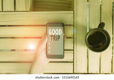 Handwriting text Good Trip. Concept meaning A journey or voyage,run by boat,train,bus,or any kind of vehicle woman computer smartphone drink mug office supplies technological devices.