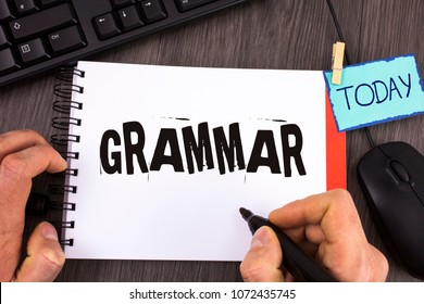 Handwriting text Grammar. Concept meaning System and Structure of a Language Correct Proper Writing Rules written by Man Notepad wooden background Marker Today Mouse Keyboard next to it.