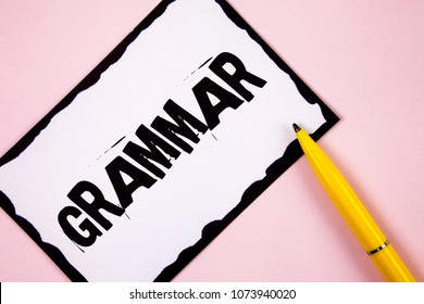 Handwriting text Grammar. Concept meaning System and Structure of a Language Correct Proper Writing Rules written on White Sticky note paper on plain Pink background Pen next to it.