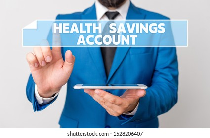 Handwriting text Health Savings Account. Concept meaning users with High Deductible Health Insurance Policy Businessman with pointing finger in front of him.