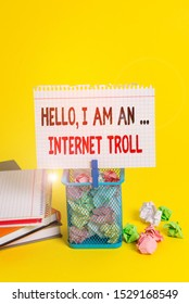 Handwriting text Hello I Am An Internet Troll. Concept meaning Social media troubles discussions arguments Trash bin crumpled paper clothespin empty reminder office supplies yellow.