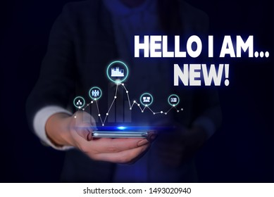 Handwriting text Hello I Am New. Concept meaning used as greeting or to begin telephone conversation Woman wear formal work suit presenting presentation using smart device.