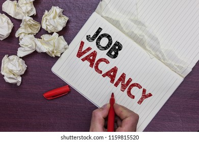 Handwriting text Job Vacancy. Concept meaning empty or available paid place in small or big company Man holding marker notebook page crumpled papers several tries mistakes.