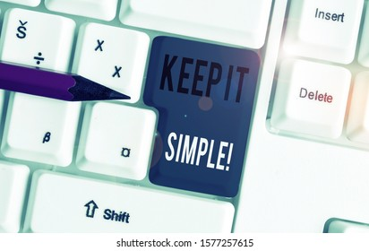 Handwriting text Keep It Simple. Concept meaning ask something easy understand not go into too much detail White pc keyboard with empty note paper above white background key copy space.