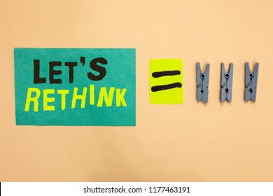 Handwriting text Let s is Rethink. Concept meaning an Afterthought To Remember Reconsider Reevaluate Turquoise paper reminder equal sign several clothespins sending message.