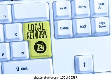 Handwriting text Local Network. Concept meaning Intranet LAN Radio Waves DSL Boradband Switch Connection White pc keyboard with empty note paper above white background key copy space.