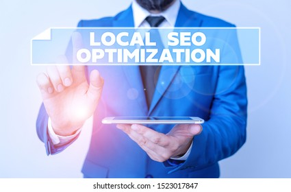 Handwriting text Local Seo Optimization. Concept meaning increase Search Visibility to Rank on Top list Businessman with pointing finger in front of him.