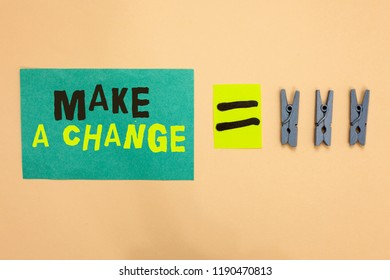 Handwriting text Make A Change. Concept meaning Create a Difference Alteration Have an Effect Metamorphose Turquoise paper reminder equal sign several clothespins sending message.