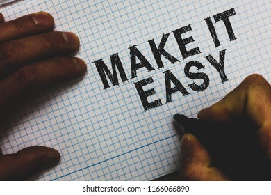 Handwriting text Make It Easy. Concept meaning Smart approach Effortless Free from worries or difficulties Man holding marker communicating ideas important messages squared paper.