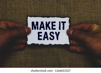 Handwriting text Make It Easy. Concept meaning Smart approach Effortless Free from worries or difficulties Man holding piece paper black borders jute background Communicate ideas.