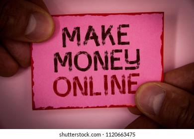 Handwriting text Make Money Online. Concept meaning Business Ecommerce Ebusiness Innovation Web Technology Words written pink paper note red border fingers holding corners message.