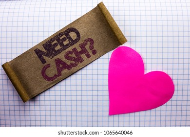 Handwriting text Need Cash Question. Concept meaning Wealth Question Needy Currency Money Advice Conceptual written on Cardboard Piece on the check background Heart next to it.