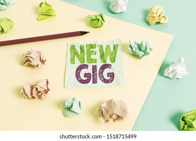 Handwriting text New Gig. Concept meaning getting job Attending live Concert Gigabyte Freelancer offer Colored crumpled papers empty reminder blue yellow background clothespin.