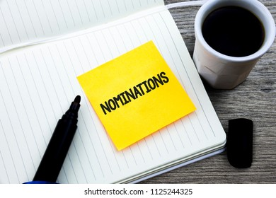 Handwriting text Nominations. Concept meaning Suggestions of someone or something for a job position or prize Study material folder card register notebook pen cap tea coffee cup table.