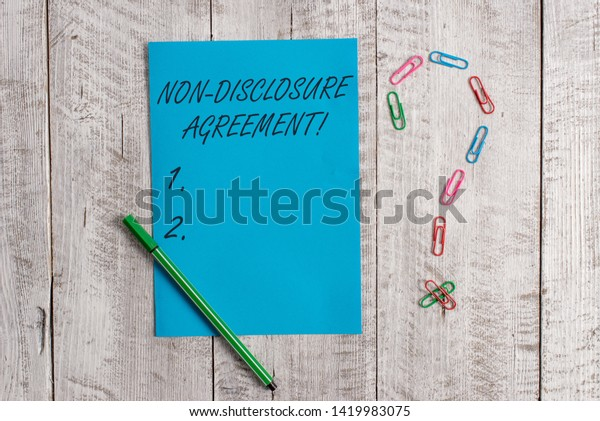 Handwriting Text Non Disclosure Agreement Concept Stock