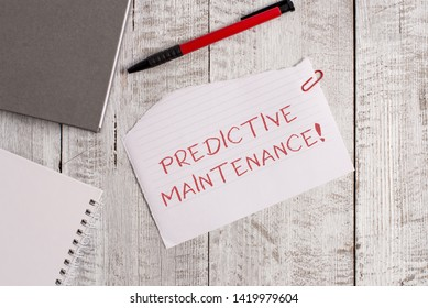 Handwriting text Predictive Maintenance. Concept meaning Predict when Equipment Failure condition might occur Torn paper and notebook sheet with a pen placed on top of wooden table.