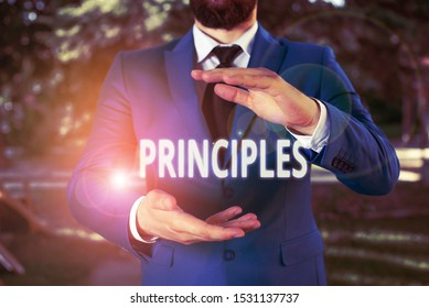 Handwriting text Principles. Concept meaning fundamental truth that serves as the base for a system of belief Man with opened hands stands in suite. Concept with copy space and man.