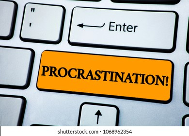 Handwriting text Procrastination Motivational Call. Concept meaning Delay or Postpone something boring written on Orange Key Button on White Keyboard with copy space. Top view.