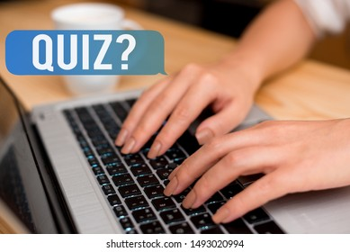 Handwriting text Quiz Question. Concept meaning test of knowledge as competition between individuals or teams woman laptop computer smartphone mug office supplies technological devices.