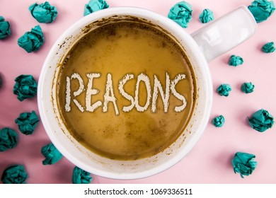 Handwriting text Reasons. Concept meaning Causes Explanations Justifications for an action or event Motivation written on Coffee in White Cup within Crumpled Paper Balls on plain pink background.