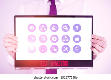 Handwriting text Seo Analysis. Concept meaning tool helps showing to study on how to improve a website ranking Male human holding thick textured cardboard of business promotion concept.