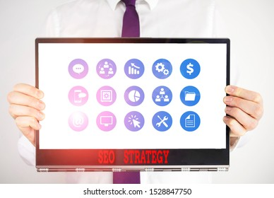 Handwriting text Seo Strategy. Concept meaning procedures that aim to increase the visibility of a website Male human holding thick textured cardboard of business promotion concept.