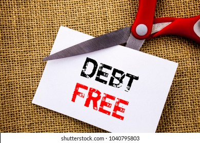 Handwriting text showing Debt Free. Conceptual photo Credit Money Financial Sign Freedom From Loan Mortage written Sticky Note Paper Cutting by Scissors the textured background