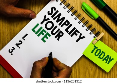Handwriting text Simplify Your Life. Concept meaning Manage your day work Take the easy way Organize Diary pen notepad ring pen marker pointer script daily work handwriting.