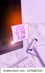 Handwriting text Stick To The Plan. Concept meaning To adhere to some plan and not deviate from it Follow Note paper taped to black computer screen near keyboard and stationary.