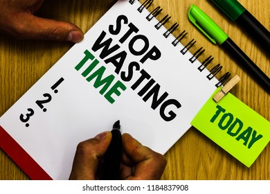 Handwriting text Stop Wasting Time. Concept meaning Organizing Management Schedule lets do it Start Now Diary pen notepad ring pen marker pointer script daily work handwriting.