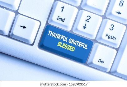 Handwriting text Thankful Grateful Blessed. Concept meaning Appreciation gratitude good mood attitude White pc keyboard with empty note paper above white background key copy space.