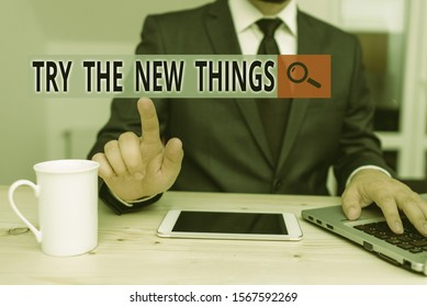 Handwriting text Try The New Things. Concept meaning Breaks up Life Routine Learn some Innovative Skills Male human wear formal clothes present presentation use hi tech smartphone.