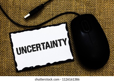 Handwriting text Uncertainty. Concept meaning Unpredictability of certain situations events behavior USB black mouse art board paper ideas thoughts ideas designs mat shadow.