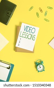 Handwriting text Video Lessons. Concept meaning Online Education material for a topic Viewing and learning Paper clips with blank papers for text messages.