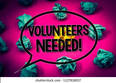 Handwriting text Volunteers Needed Motivational Call. Concept meaning Social Community Charity Volunteerism Huge emerald paper lobs surroundes yellow paper ball magenta color floor.