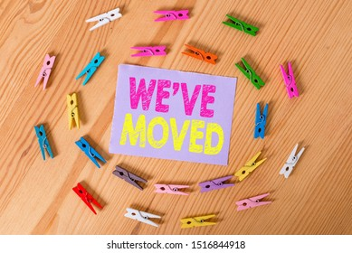 Handwriting text We Ve Moved. Concept meaning going to live from place another same or different country Colored clothespin papers empty reminder wooden floor background office.