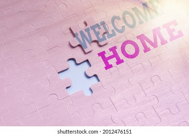 Handwriting text Welcome Home. Internet Concept Expression Greetings New Owners Domicile Doormat Entry Building An Unfinished White Jigsaw Pattern Puzzle With Missing Last Piece
